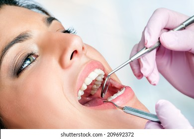 Macro close up of woman having dental check up in clinic.