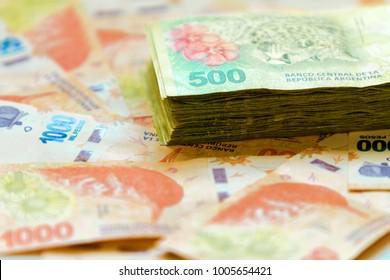 Macro close-up of 500 Argentine pesos bills stacked on 1000 pesos bills