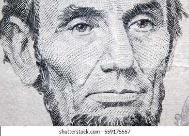 Macro closeup Abraham Lincoln on five dollar bill