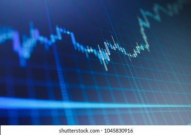 Macro close-up. Blue background with stock chart. Candle stick graph chart of stock market investment trading Data analyzing in forex market: the charts and quotes on display.