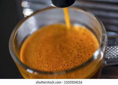 macro closeup of cappuccino machine making cup of coffee - soft focus for effect