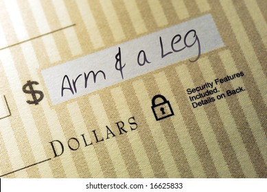 Macro Closeup of Check Made Out for An Arm And A Leg