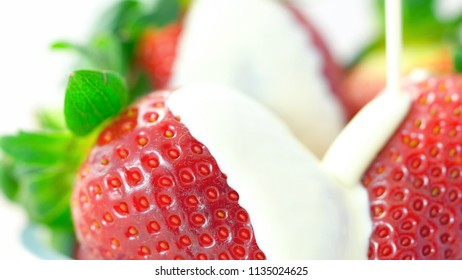 Macro closeup of fresh strawberry fruit with cream.