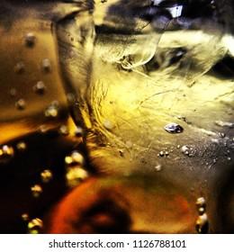 Macro closeup ice cube in drink