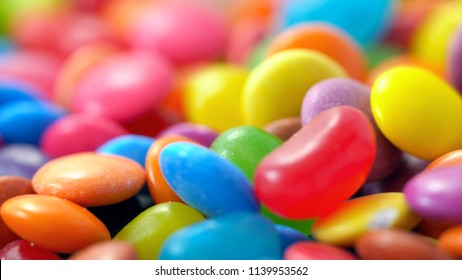 Macro closeup of multi color candy and jellies, colorful background.