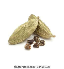 Macro closeup of Organic Green or True cardamom (Elettaria cardamomum) with seeds isolated on white background.