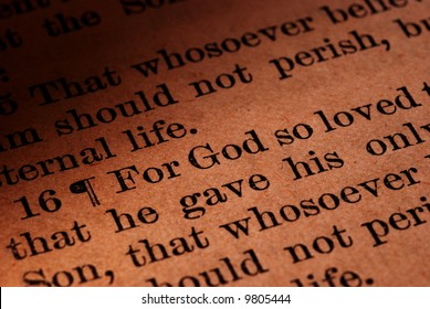 Macro close-up of a scripture passage from the New Testament (John 3:16) in a very old Bible.