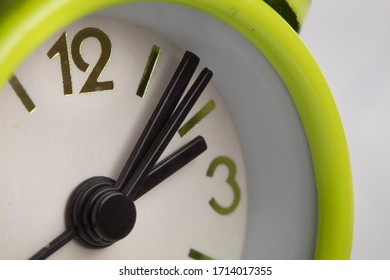 macro or close-up shot of the alarm clock with hour and minute hand. it could be use as sleeping, oversleeping, business, home concepts.