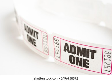 A macro or close-up shot of a strip of generic white sequentially numbered admittance paper ticket.