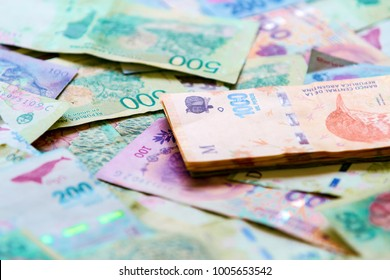 Macro close-up of stack of 1000 Argentine pesos bills over others of different value