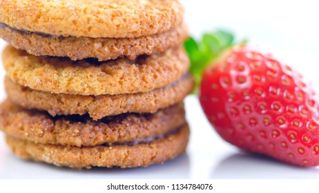 Macro closeup of stack of cookies with strawberry.
