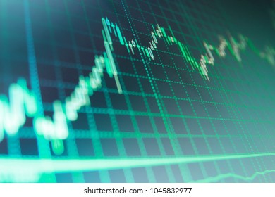 Macro close-up. Stock diagram on the screen. Bitcoin market graph on the screen. Stock market chart, graph on blue background.  Forex market candle graph analysis on the screen.