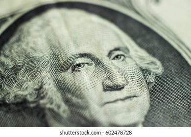 Macro close-up of Washington's Face on a one dollar bill
