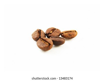 macro of coffee beans on the white background