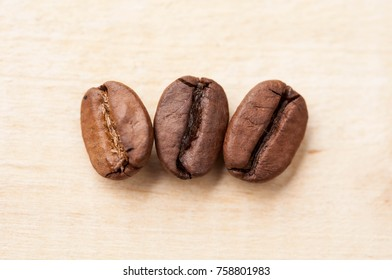 Macro of coffee beans on wooden background