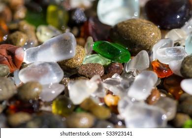 macro of a colorful group of sea glass pieces under bright sunshine