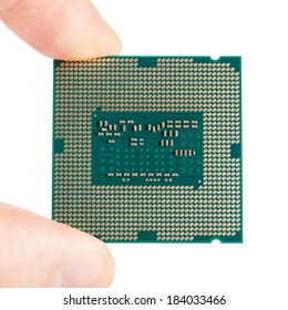 Macro of a computer's processor in hand isolated on a white background - 1 to 1 ratio