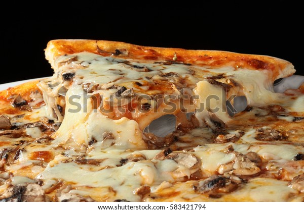 macro delicious pizza with cheese and mushrooms on a dark background studio