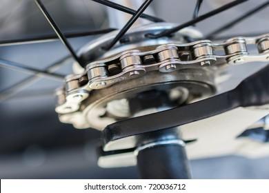 macro detail of a chain of a fixie bike