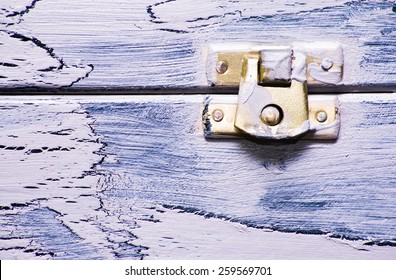 Macro detail of the closure of a vintage wooden box useful as background