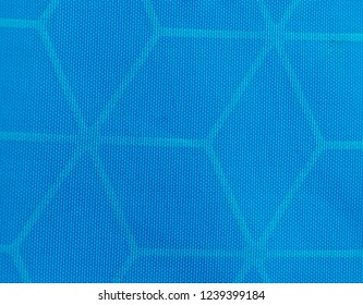 Macro detail view of woven synthetic waterproof blue nylon clothing fabric. Water Resistant Textile Coating Close Up.