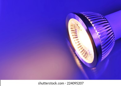 macro detail of a warmwhite COB-LED in blue-violet spotlight