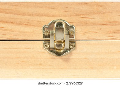 Macro detail of a wooden box metal latch.