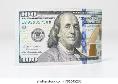 Macro detailed, white isolated, Concept image of US economics. 100 dollar bill with and American founding father Benjamin Franklin