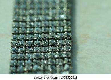 Macro diamond rows bracelet on white marble background