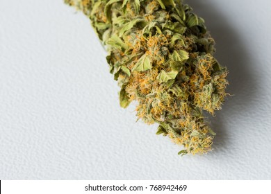 MACRO Dried Medical Marijuana grown at home. Close up of a Cannabis leaves and Female Flowers. Healing medicine Mental Health.