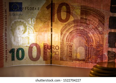Macro of an european bank note in closeup with backlight showing its watermark as financial security feature for safety in financial payment in europe and cash money exchange