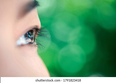 Macro of eye or eyeball black color of asian woman with eyebrow, eyelash and eyelid in concept eye health and vision in life