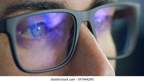 macro eyes web surfer and the office worker, insurance broker, workaholic, while working in the office evenings, control and security in the accesses, security, concept of internet web application.