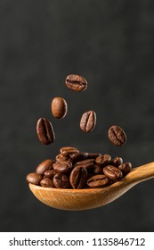 Macro falling coffee bean on gray background. Levitation coffee beans. Food ingredients,  space for text