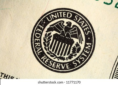 Macro of the Federal Reserve seal printed on a US banknote.
