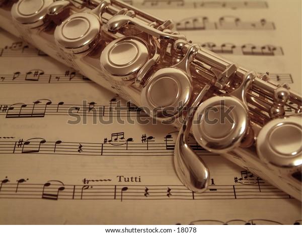 Macro of flute detail on sheet music