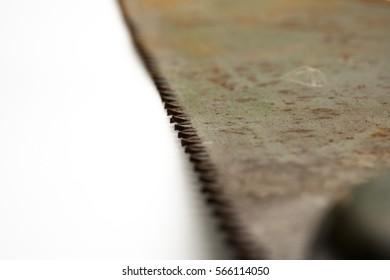 Macro focus on part of rusty blade or vintage handsaw isolated white background.