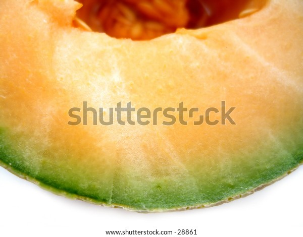 Macro focusing on the textures of a cantaloupe.
