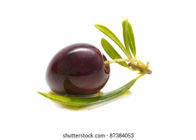 macro of a fresh olives bathed in olive oil