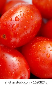 macro of freshly washed red grape tomatoes