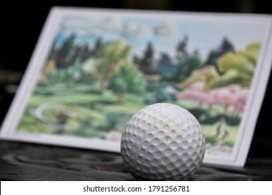 Macro of golf ball with scorecard in background