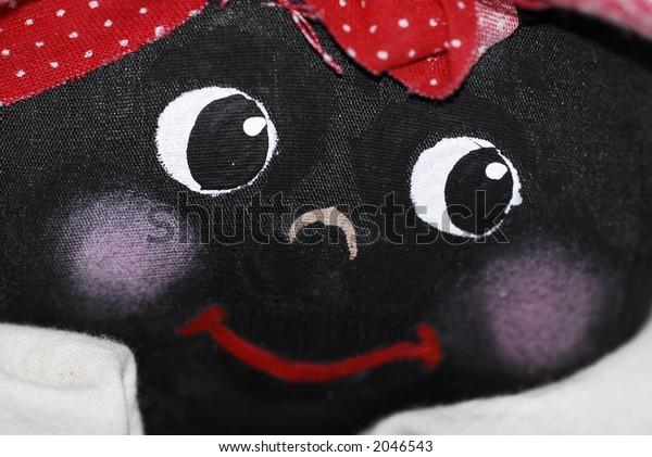 Macro of a hand-made black doll's face