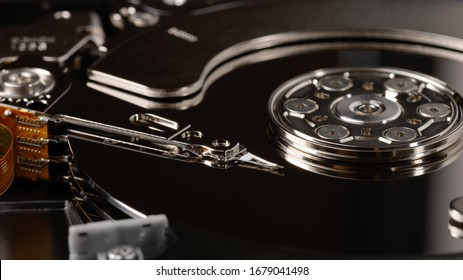 Macro hard drive. HDD. Modern technologies, computer memory, storage of large databases background in dark colors.