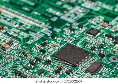 Macro image of a green computer printed circuit board with selective focus on an blank chip