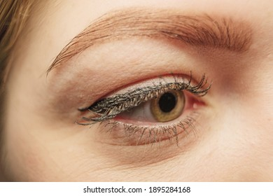 Macro image of lady's eye with mascara inb the form of arrow.