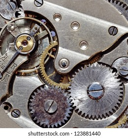 Macro image of a metallic mechanical watch component.