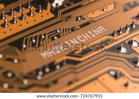 "Macro image of a motherboard with the inscription ""Made in China""."