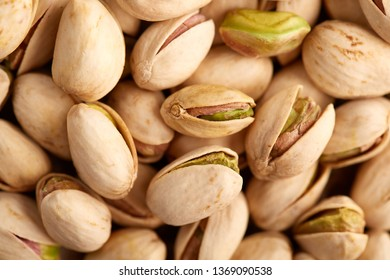 Macro image of nicely roasted pistachio in closeup detail with visible seeds and shells