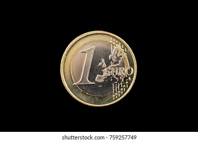 A macro image of a one Euro coin isolated on a black background