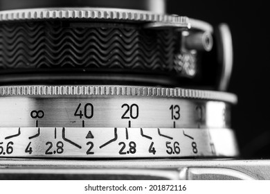Macro image of the shutter speed adjustment on a vintage range-finder camera